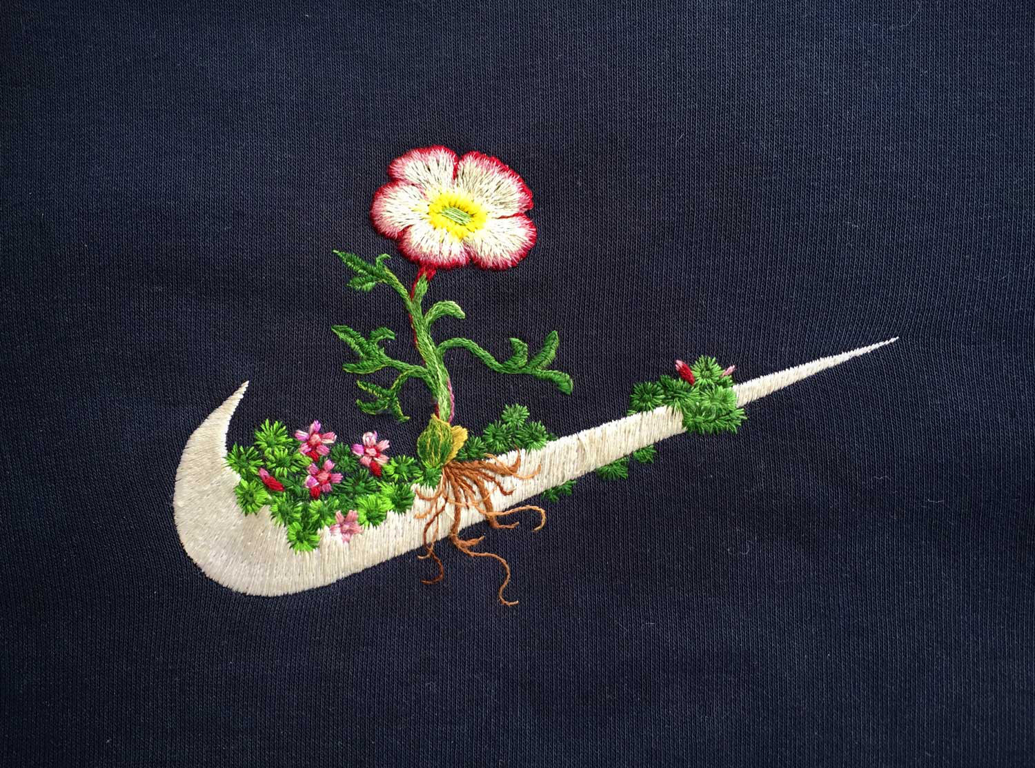 Embroidered sweater by James T Merry