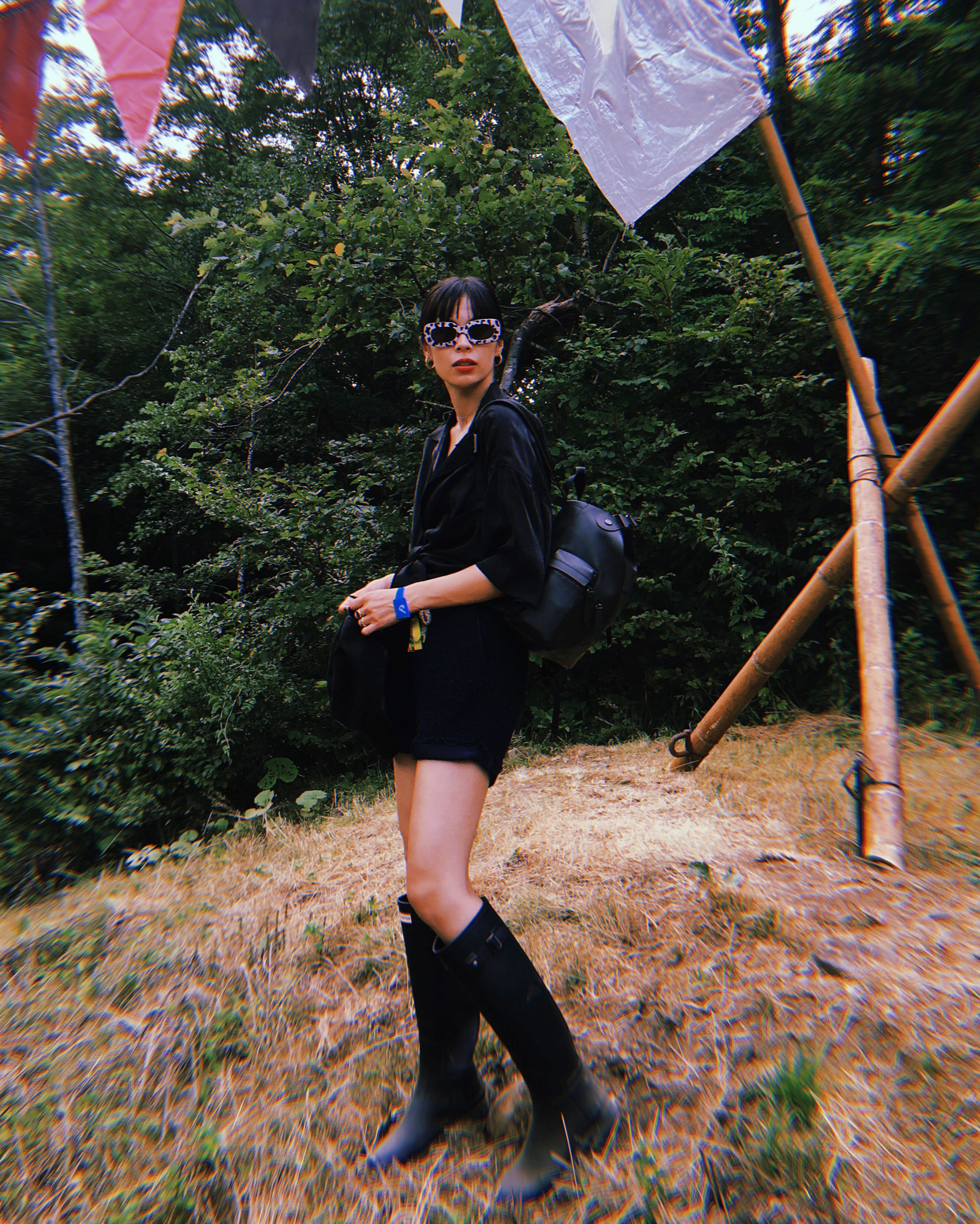 Sara Mary wearing Original Tall Boots and Mini Top Clip Rubberized leather Backpack by Hunter